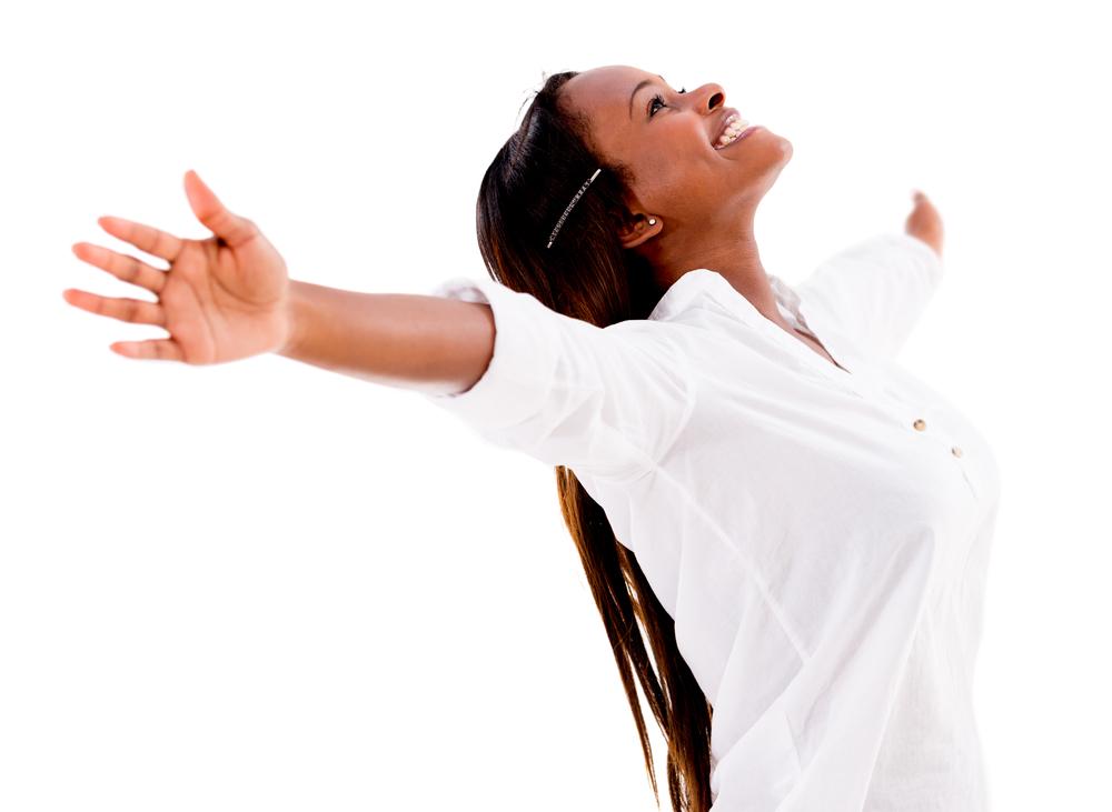 Happy woman enjoying her freedom - isolated over white background